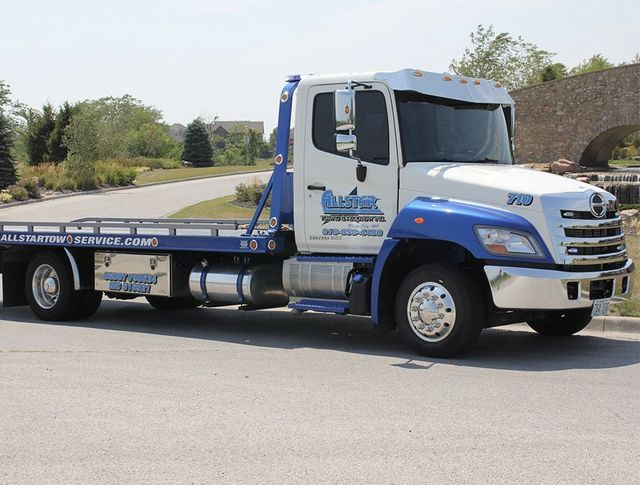 Allstar's new blue and white flatbed tow truck