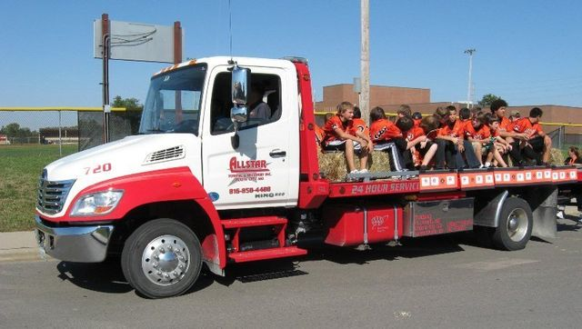 Allstar towing hauling kids on the flatbed