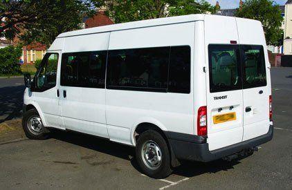 A parked white minibus