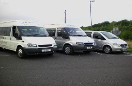 Two minibuses and a people carrier