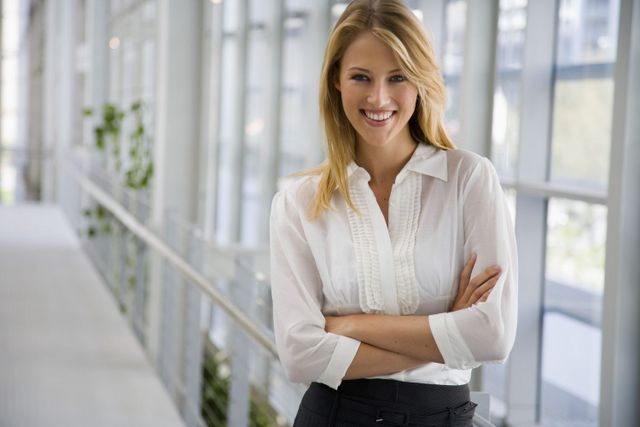 Woman satisfied with the cosmetic dentist in Cincinnati, OH