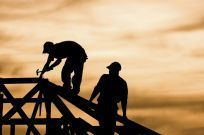 Silhouette of roofing workers