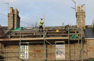 A man tiling a roof