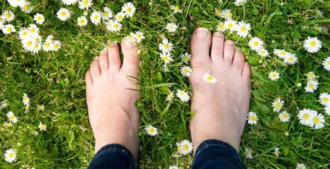 feet on the grass