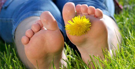 feet with a flower