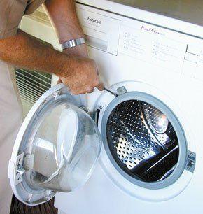 Man fixing a washing machine
