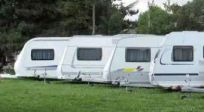 several RVs parked at a campsite