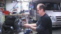 man repairing RV hook up