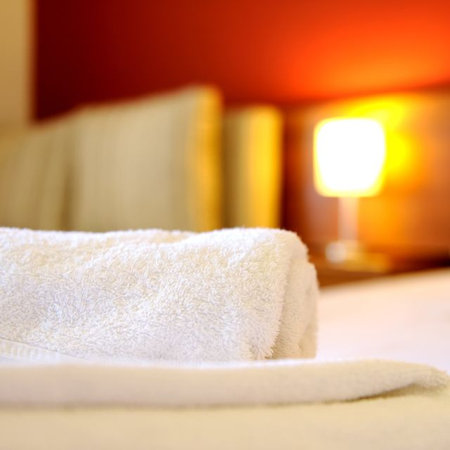 A nice looking hotel room with a clean white towel