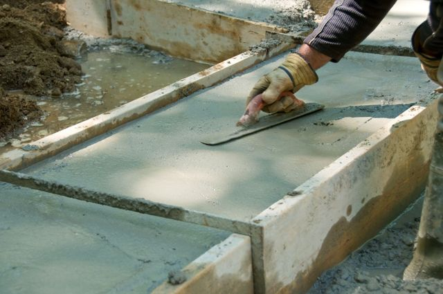A worker working with concrete offers great concrete prices in Anchorage, AK