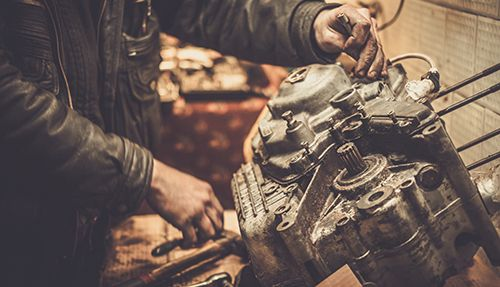 Mechanic repairing motorcycle engine in Texarkana
