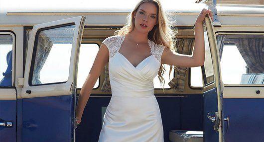 bride posing infront of a van