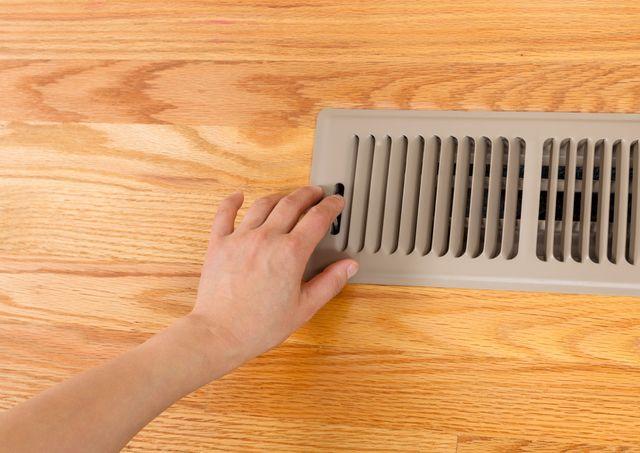 Opening floor vent heater