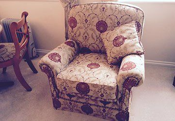 A Comfy Chair With A Beautiful Fabric