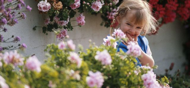 Young girl enjoying a garden designed by landscaping contractors in Tauranga