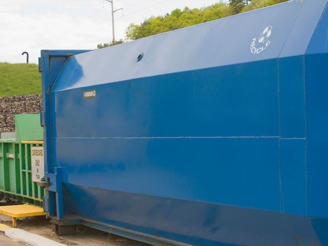 Large blue waste compactor