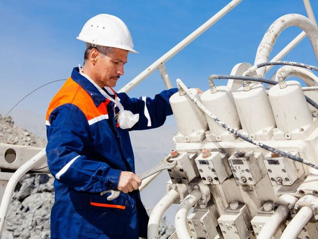 Engineer repairing hydraulic power pack