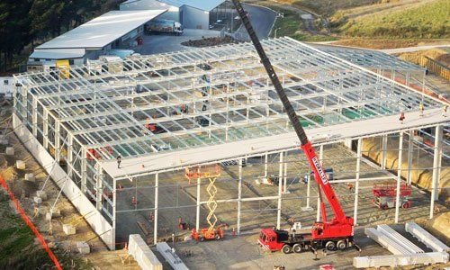 Hydralift crane working on commercial building
