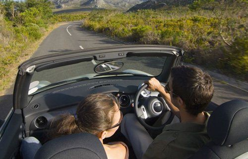 Couple driving happily after their repaired windscreen