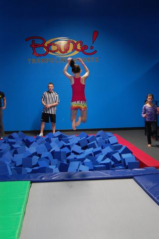 Young Woman Jumping In Soft Cubes — Springfield, MA — Bounce Family Entertainment
