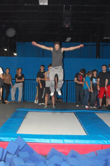 Young Man Jumping On Classic Trampoline — Springfield, MA — Bounce Family Entertainment
