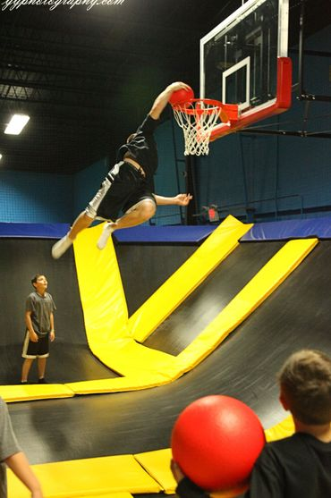 Man Playing Basketball On Trampoline — Springfield, MA — Bounce Family Entertainment