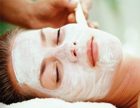 applying a face mask to female client