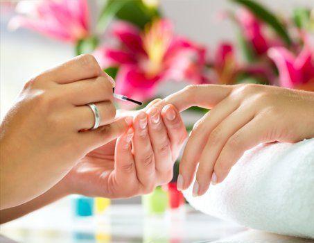client having nail treatment
