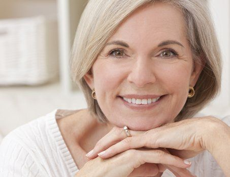 older female client with white smile and youthful hairstyle