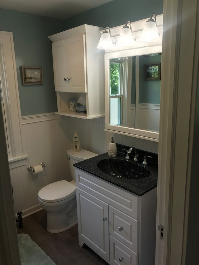 After Picture Of A Bathroom In Buffalo, NY With A Sink And Toilet, New
