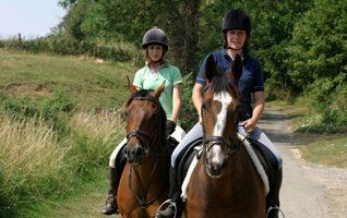 2 ladies learning horse riding