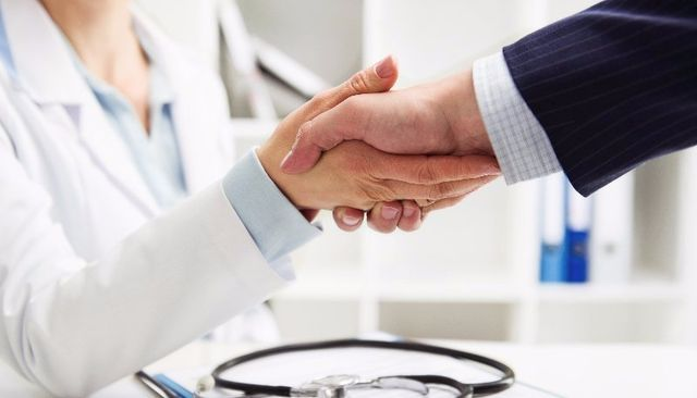 doctor shaking hands with client