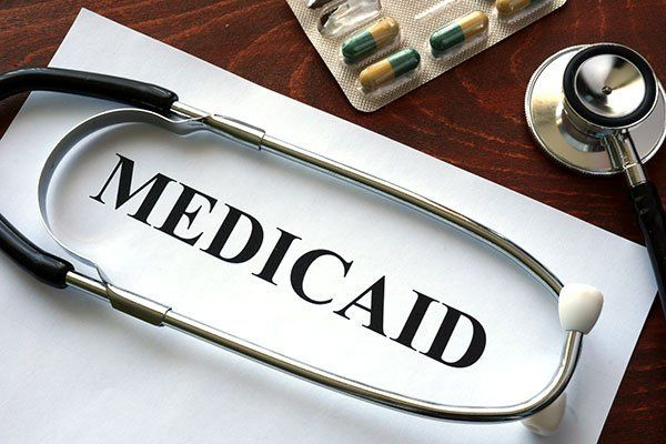 Paper with Medicaid and stethoscope