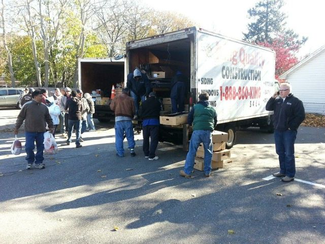 king quality construction donates turkeys to lighthouse mission