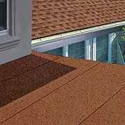 King Quality Construction installs low-slope membrane roofing.