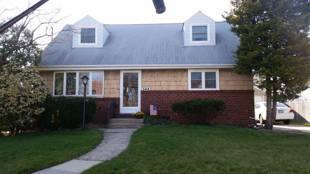 King Quality Construction - siding & roofing before picture