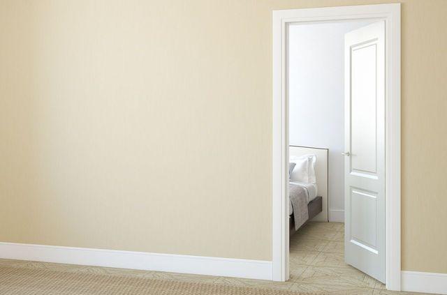 An open door after door servicing in Auckland