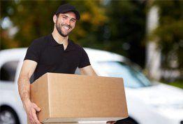 A smiling courier delivering a parcel