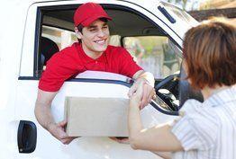 A courier handing a woman a parcel