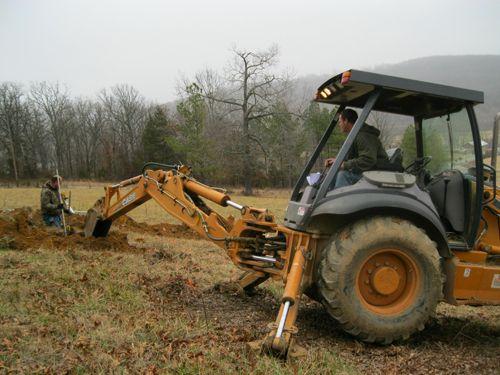 Excavator we use for plumbing service