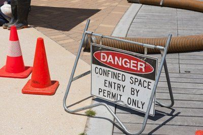 danger sign warns of confined work space