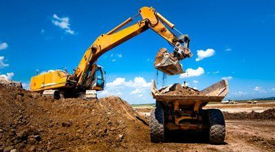 Industrial truck loader excavator moving earth and unloading