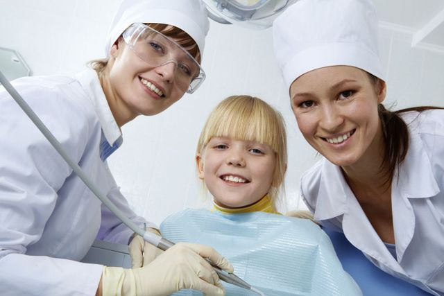 A girl is receiving dental services in our dental practice in Columbia, MO