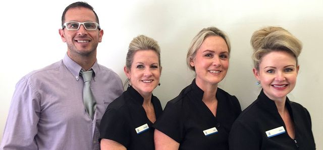 blue apple dental team photo