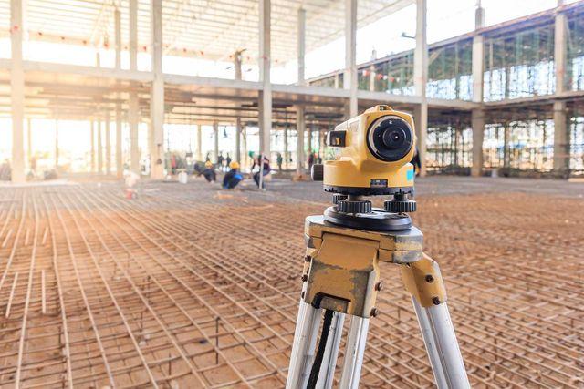 Surveyor equipment tacheometer or theodolite outdoors at construction site