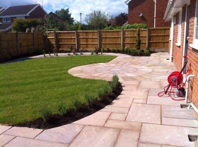 indian stone patio and turfed lawn area