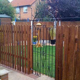 picket fencing and steel gate