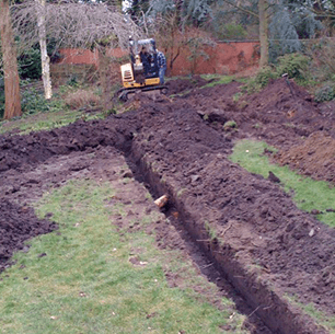 digging a trench with mini excavator
