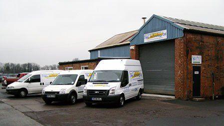 white mobile vans