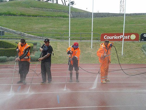 Sports track being cleaned by professionals